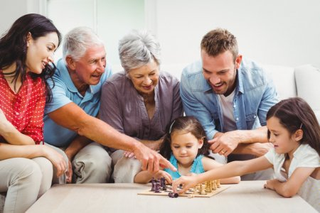 Family Therapy - multi-generational family playing games